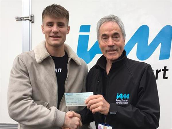 Christian Rodley with our Chair John Norrie, receiving his £100 cash back