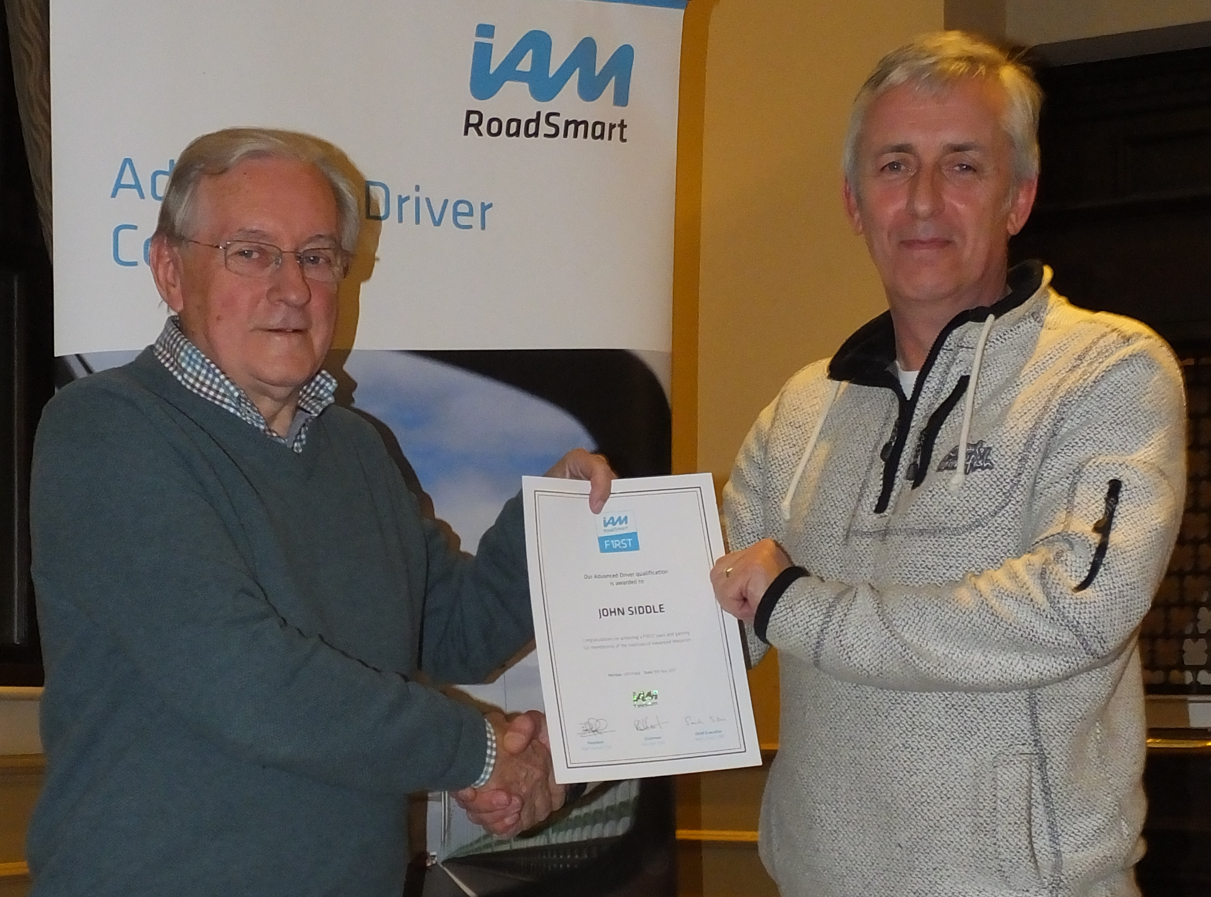 Roger Hicks presents John Siddle with his certificate